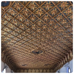 The ceiling of one of the main rooms